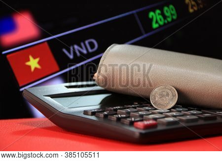 Two Hundred Vietnam Dong Coin On Obverse (vnd) On Black Calculator And Wallet On Red Floor With Digi