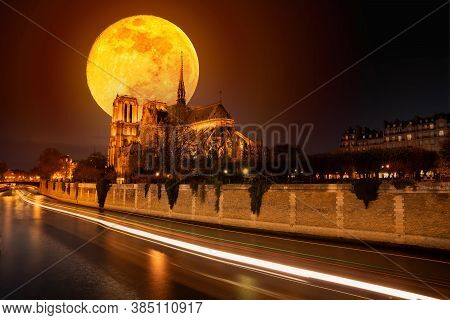 Moon Over Notre Dame Cathedral Before It Burned With Ships Trails On The Water At Night In Paris