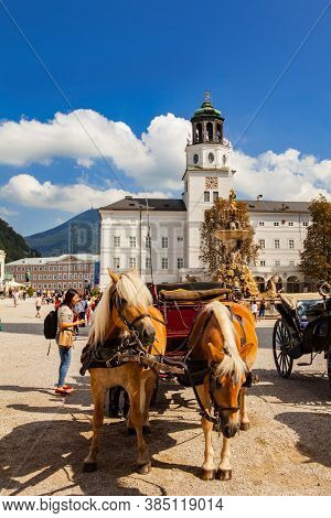 Salzburg, Austria - September 8, 2018: The Horse Drawn Carriages In Old Town Are The Popular Tourist