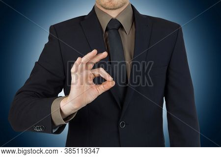 Young Successful Businessman Showing Okay Symbol / Concept