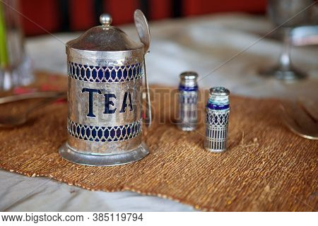 Antique Tea Set With Spoon On The Table