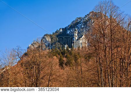 Famous Neuschwanstein Castle In The Bavarian Alps Of Germany.