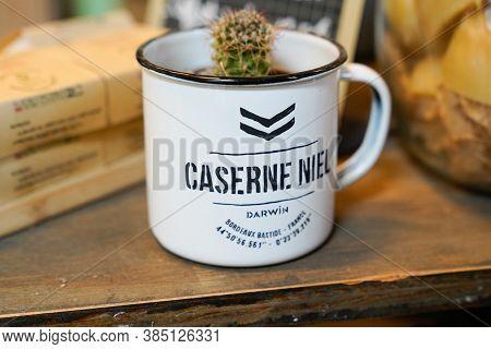 Bordeaux , Aquitaine / France - 09 01 2020 : Caserne Niel Darwin Logo Sign On Vintage Mug Retro Of A