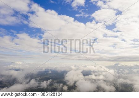 Aerial View Clouds Over The Forest And Lake . View From Drone. Aerial Top View Cloudscape. Texture O