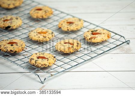 Homemade Delicious Cookies With Almonds On Top Arrange On Stainless Griddle