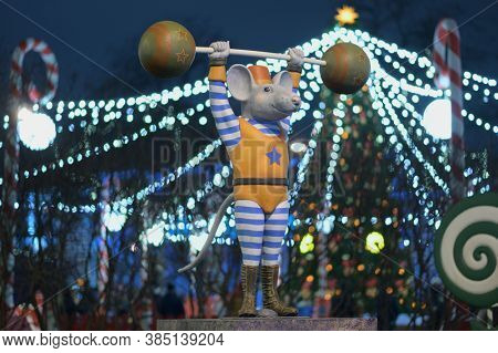St. Petersburg, Russia - December 14, 2019: Statue of circus mouse on the New Year and Christmas Fair on Manege square. More than 20 statues of mouses symbolizing the Chinese year of mouse was install