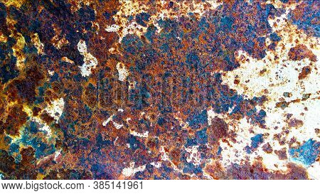 Rust And Corrosion Of Old Metal Painted With White Paint Interspersed With Turquoise Spots .corrosio