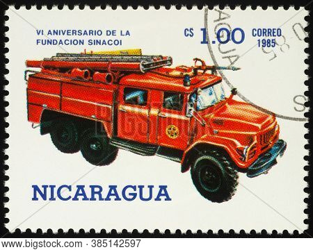 Moscow, Russia - September 13, 2020: Stamp Printed In Nicaragua Shows Red Fire Rescue Vehicle, Circa