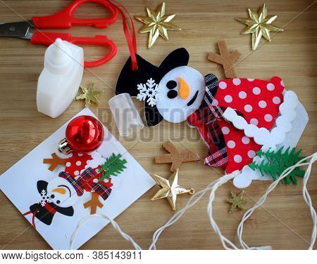 Christmas Background With A Snowman. We Make A Toy Snowman For The Christmas Tree From Pieces Of Fab