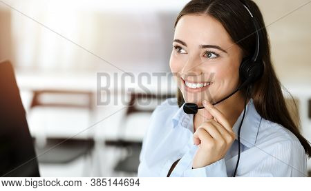 Brunette Female Customer Service Representative Using Headset And Consulting Clients Online. Call Ce