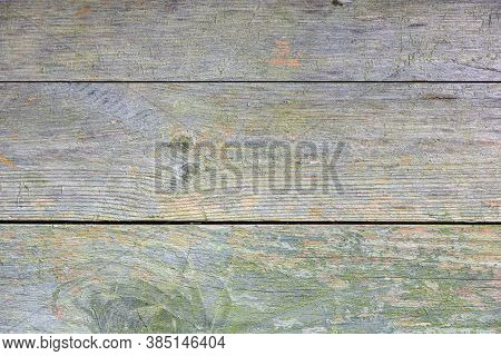 Old Weathered Wooden Surface With Moss. Wood Pattern With Knots. Grunge Background With Scratches An