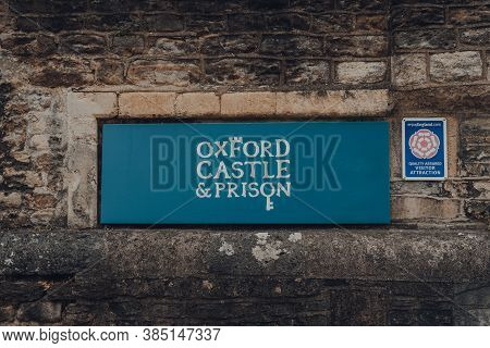 Oxford, Uk - August 04, 2020: Sign On A Stone Wall Outside Oxford Castle & Prison, A Large Partly Ru