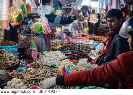 Kathmandu, Nepal - December 22 2019: Unidentified People Attends A Local Street Market And Buys And