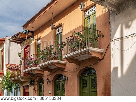 Panama City, Panama - November 30, 2008: Flowerly Balconies On Brown Painted Houses Along Quiet Down