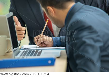 Business People Signing A Contract A Document.