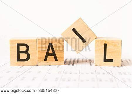 Word Bail. Wooden Small Cubes With Letters Isolated On White Background With Copy Space Available