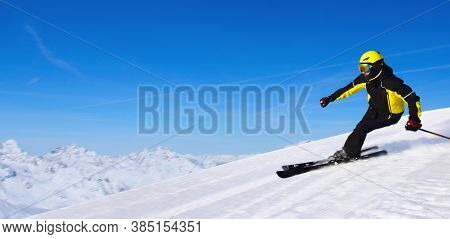 Professional Alpine Skier Skiing Downhill In High Mountains Of Alps Banner Background With Copy Spac