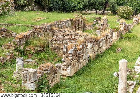 Ancient Greek Ruins In Old Agora, Athens, Greece. Urban Landscape In Athens City Center, Scenery Of