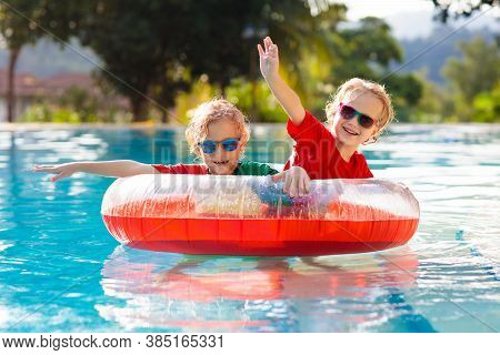 Kids In Swimming Pool. Life Jacket For Child.