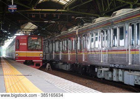 Jakarta, Indonesia - November 25, 2018: Indonesian Commuter Trains (krl / Commuter Line) Pass Gambir