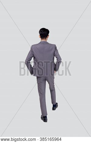 Back View Young Asian Business Man In Suit Walking Isolated On White Background, Portrait Of Executi