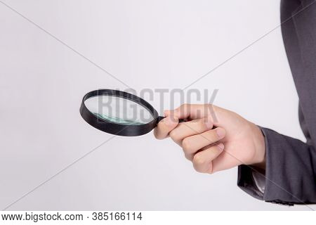 Closeup Young Asian Business Man In Suit Look Magnifying Glass For Search Isolated On White Backgrou