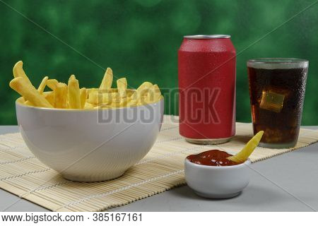 Portion Of Potato Fries In A Bowl With Soda And Ketchup