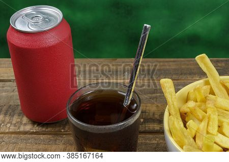 Portion Of Potato Fries In A Bowl With Soda