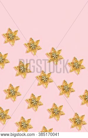 Christmas Decorations, Regular Pattern With Golden Colored Toys In Shape Star Or Flower On Millennia
