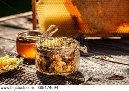 Honey In Jar With Honey Dipper, Honey Background. Fresh Honey In The Pots On Wooden Table. Bee Produ