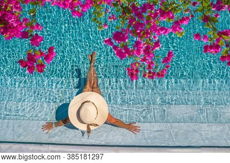 woman in luxury five stars  spa resort in the swimming pool.