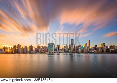 New York City skyline on the East River with Midtown Manhattan at sunset.