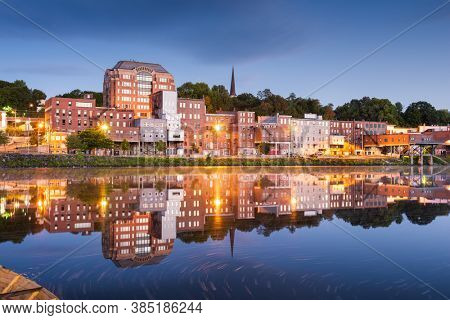 Augusta, Maine, USA downtown skyline on the Kennebec River.