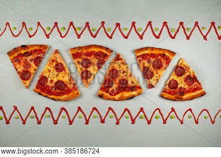Tasty pizza pattern. Piece of pepperoni pizza pattern on grey background with pattern frame of ketchup and guacamole. Flat lay, top view.