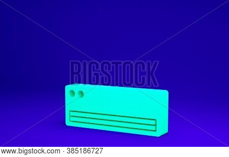 Green Air Conditioner Icon Isolated On Blue Background. Split System Air Conditioning. Cool And Cold