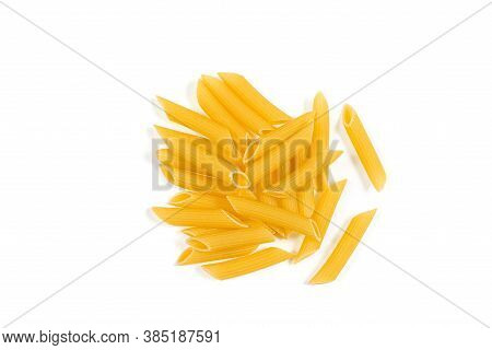 Uncooked Penne Pasta Isolated On White Background. Top View. Heap Of Dry Penne Pasta