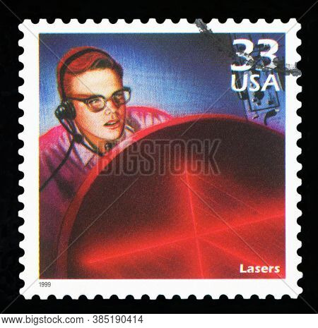 United States Of America - Circa 1999: A Postage Stamp Printed In Usa Showing An Image Of A Man Watc
