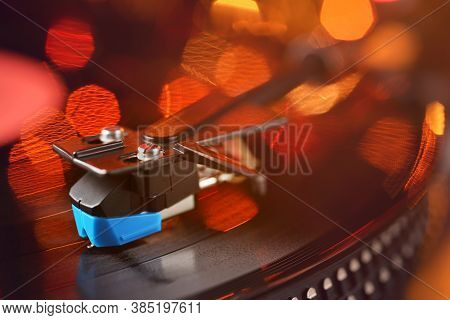 Vinyl Player Tonearm With Lp Record And Blured Or Defocused Lights. Party Disco Concept
