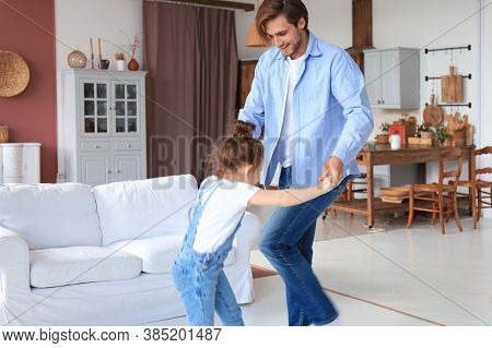 Handsome Young Man Dancing At Home With His Little Cute Daugther.