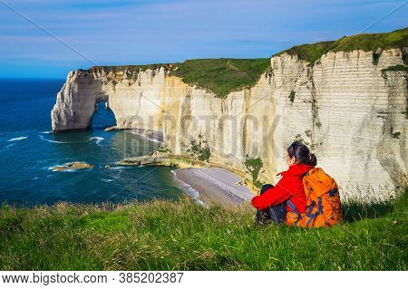 Carefree Happy Traveler Woman Relaxing And Enjoying The View With Sea. Backpacker Woman Sitting In T