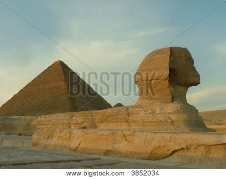 Sphinx In Front Of The Great Pyramid In Giza, Egypt