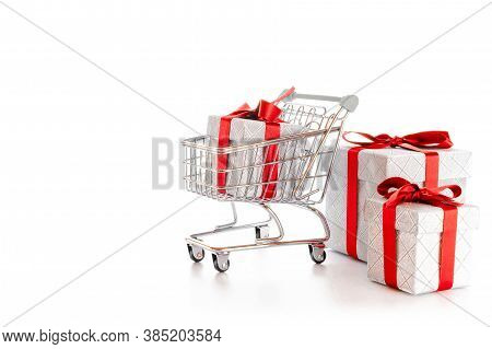 Xmas Sale. Trolley Cart For Supermarket With Christmas Or Birthday Gift Box Isolated On White Backgr