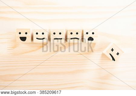 Wooden Cubes That Express Different Emotions. Smile Face Icon Symbol On Wooden Cube On Wooden Backgr