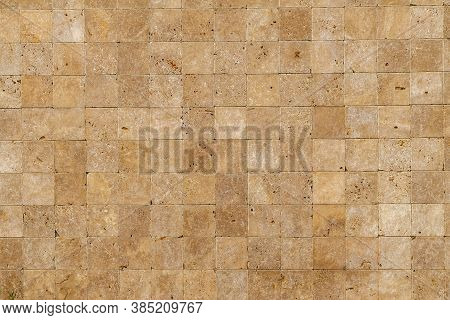 Wall Background With Yellow Natural Sandstone Tiles Stiched Together With Clay