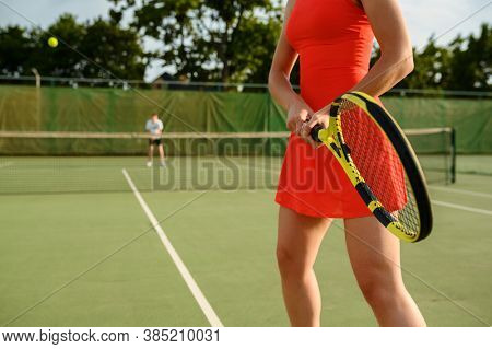 Tennis players, training on outdoor court