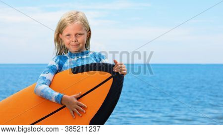 Happy Baby Girl - Young Surfer Learn To Ride On Surfboard With Fun On Sea Waves. Active Family Lifes