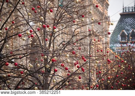 Multicolored Decoration Balls On The Trees And Festive Illumination On The Walls And Streets Of The