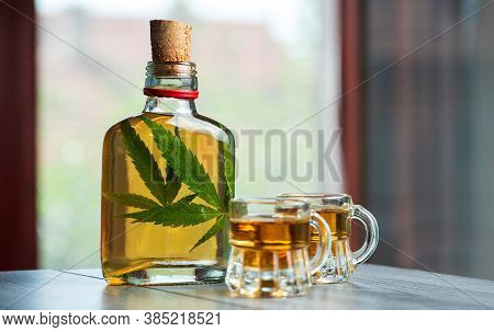 Alcoholic Drink Whiskey Brandy Or Schnapps Infused With Marijuana With Cannabis Leaf In The Bottle