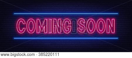 Coming Soon Neon Script Sign On Brick Wall Background.
