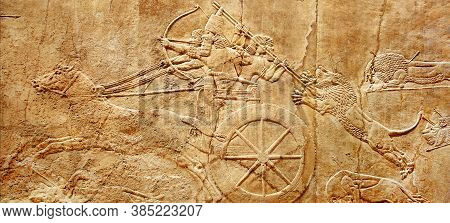 Assyrian Wall Relief Of Lion Hunt, King Ashurbanipal With Warriors On Carving From Middle East And M